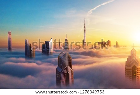 Dubai sunset panoramic view of downtown covered with clouds. Dubai is super modern city of UAE, cosmopolitan megalopolis. Very high resolution image #1278349753