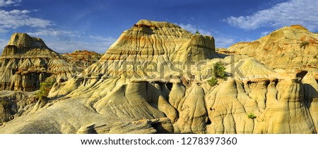 Large hoodoo mountain of the Dinosaur Provincial Park in the Canadian Badlands, Alberta - UNESCO World Heritage Site Royalty-Free Stock Photo #1278397360