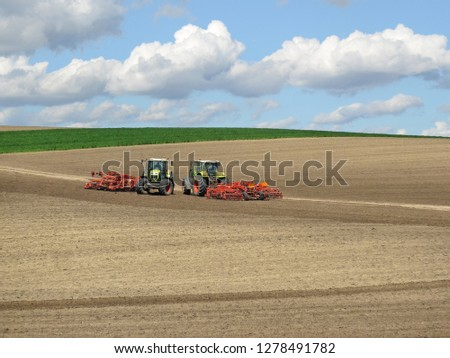Powerful tractors and plowed fields in northern Serbia (cultivated land) #1278491782
