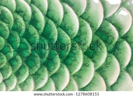 Beautiful green blue fish scale pattern tile background, close up shiny ceramic decorated with stacking curve design turquoise color, gradient cracking background texture of pottery, luxury pattern #1278608155