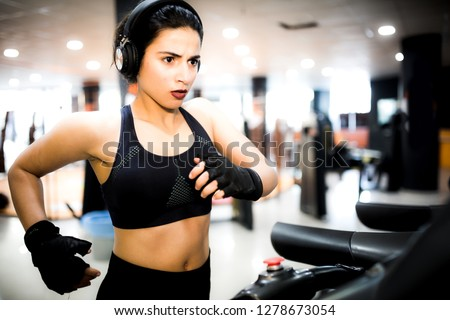 Young woman working out in the gym #1278673054