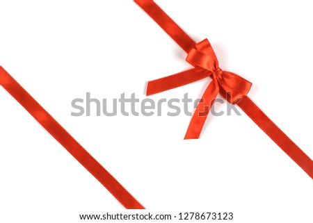 Shiny red silk ribbon isolated on white background. Festive concept. Flat lay. #1278673123