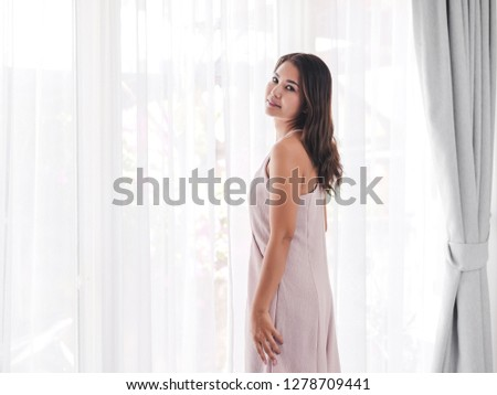 Happy Asian woman relaxing near window at home, lifestyle concept. #1278709441