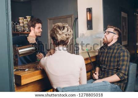 pleasant conversation with barmen. closeup photo, sspending time with old friends #1278805018
