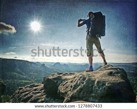 Abstract, over filtered. Hiker in outdoor windbreaker jacket enjoys the magnificent view.  The feeling of strength and power. Wonderful view. #1278807433