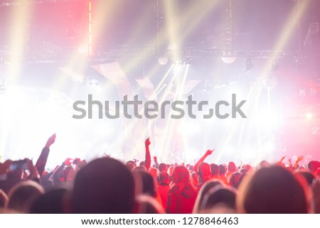 Silhouette of a concert crowd. The audience looks towards the stage. #1278846463