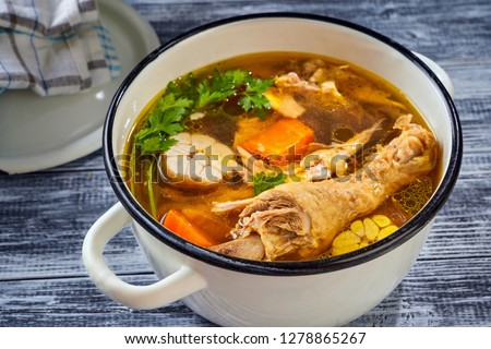 Hearty and nutritious rooster broth with vegetable #1278865267