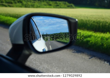 The Beautiful View in the Rearview Mirror of the Car. #1279029892