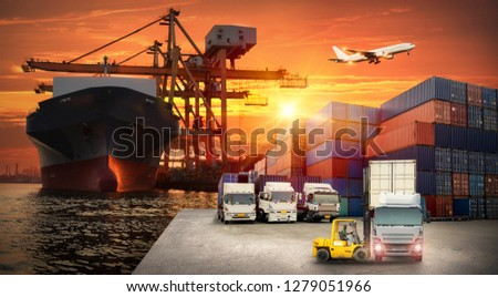 Logistics and transportation of Container Cargo ship and Cargo plane with working crane bridge in shipyard at sunrise, logistic import export and transport industry background #1279051966