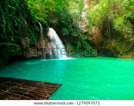 Kawasan waterfall in a mountain gorge in the tropical jungle of the Philippines, Cebu. #1279097071