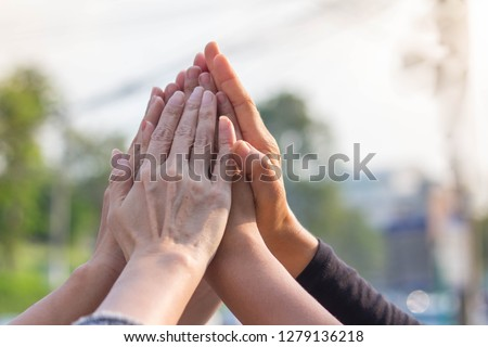 Success Teamwork hi five hand tag team #1279136218