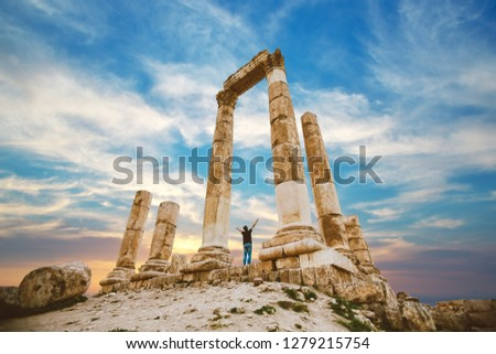 the citadel in the city of Amman in Jordan in the middle east at the sunset. Temple of Hercules of the Amman Citadel (Jabal al-Qal'a) with a young man #1279215754