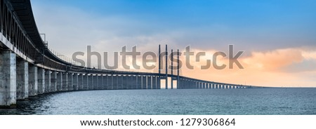 Panoramic view of Oresund bridge during sunset over the Baltic sea #1279306864