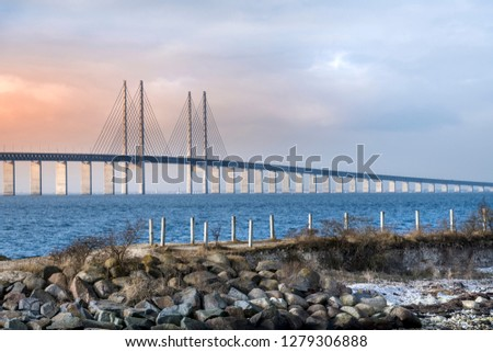 View of Oresund bridge during sunset over the Baltic sea #1279306888