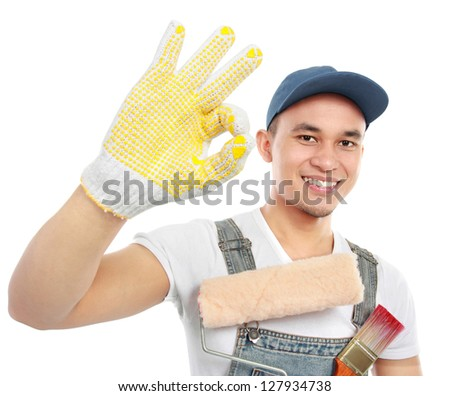 Painter showing ok sign isolated over white background