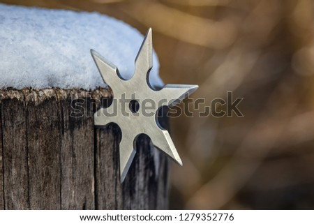 Shuriken (throwing star), traditional japanese ninja cold weapon stuck in wooden background #1279352776