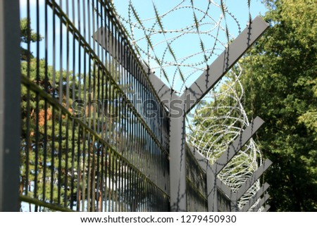 Barbed wire fence, border, border fence #1279450930