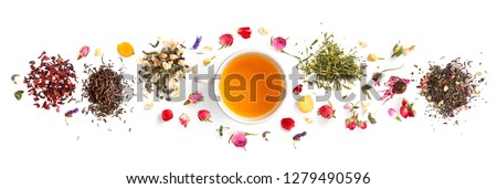 Creative layout made of cup of tea, green tea, black tea, fruit and herbal, tea, turmeric, ginger on white background.Flat lay. Food concept. #1279490596