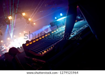 Professional sound engineer console at concert. Remote control for sound engineer. Professional audio sound mixer console and music equipment, electronic device. Remote concert sound engineer at work. #1279521964