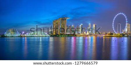 Singapore skyline with landmark buildings at night. #1279666579