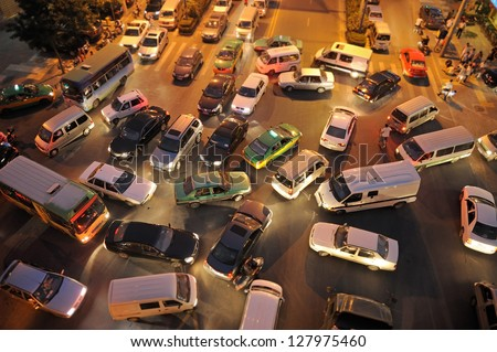 Messy traffic at crossroad in China. Night Time, aerial view Royalty-Free Stock Photo #127975460