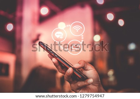 Communication fintech sign icon and connection screen of smartphone with blur cafe coffee shop background. Financial business technology freedom dream life using internet freedom life concept. #1279754947