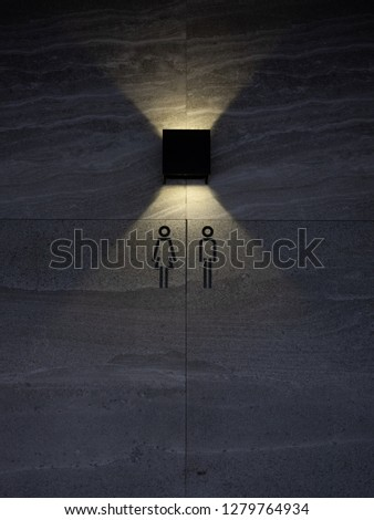 The restroom sign with lighting decoration.