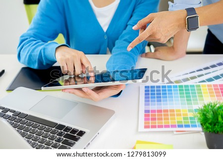Graphic design and color swatches and pens on a desk. Architectural drawing with work tools and accessories. #1279813099