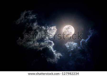 Full moon shining on the sky in cloudy day. #127982234