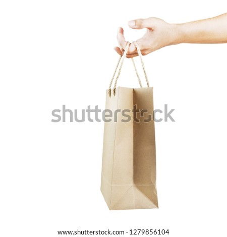 Using paper bag for shopping, isolated of hand holding paper bag on white background #1279856104