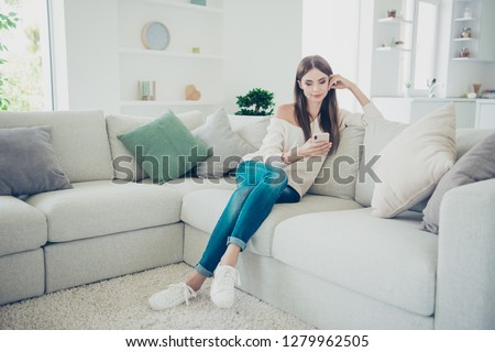 Close up photo of wonderful pretty attractive she her lady with telephone in hand writing letter for husband wearing casual jeans and white knitted pullover sitting  #1279962505