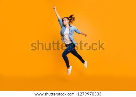 Full length body size view of nice attractive slim sporty sportive fit thin school girl raising hand looking up in air excellent result isolated over bright vivid shine yellow background #1279970533