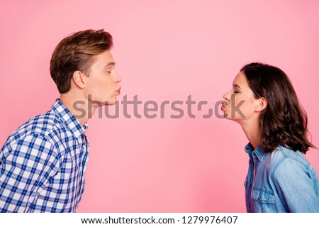 Profile side view portrait of nice sweet charming adorable lovely attractive flirty couple reaching out to each other closed eyes isolated over pink pastel background #1279976407