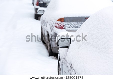 Parked cars covered with snow #128001875