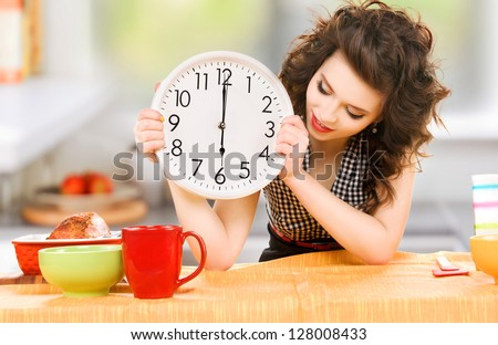 picture of young attractive woman in the kitchen