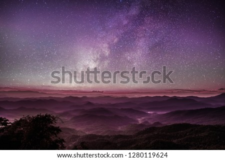 Milky way purple sky sunset with scenery beautiful romantic mountain hill and fog in Chiang Mai , Thailand.  #1280119624