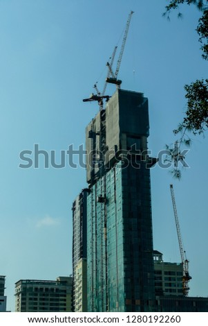 silhouette of crane on background of sky, digital photo picture as a background #1280192260