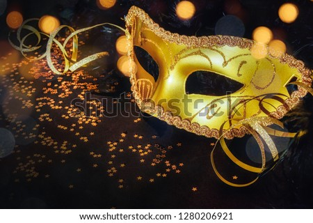 female carnival mask with bokeh background