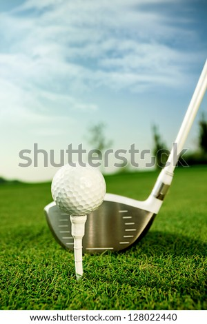 Golf equipment, golf ball with tee on course and stick #128022440