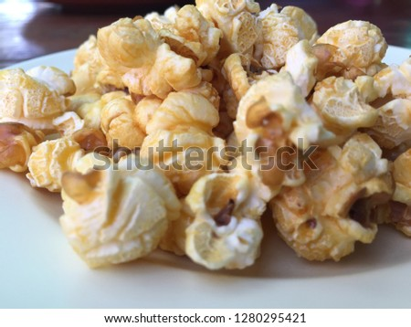 Popcorn in a white dish #1280295421