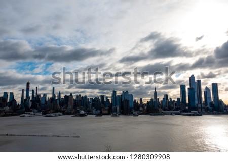 New York City Skyline Morning Sun Across the Hudson River #1280309908