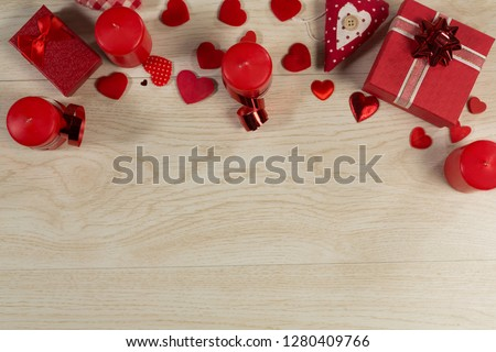 Overhead of gift boxes and heart shape decorations on wooden table #1280409766