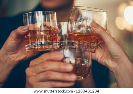 Three people makes a toast with whiskey #1280431234