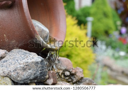 Waterfall decoration in the garden #1280506777