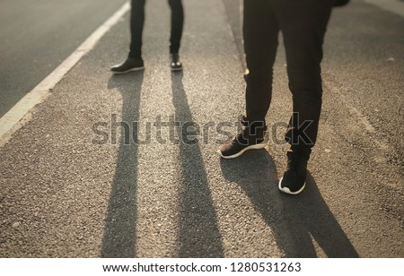 low section of two people standing on asphalt ground  - Social Distancing Concept #1280531263