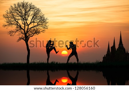 Silhouette of a thai's boxing at sunset Royalty-Free Stock Photo #128056160