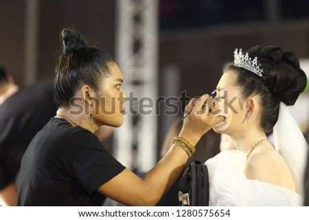 "Bangkok, Thailand - January 9, 2019 ; Make Up Artists Contestant start to make up creative design wedding style to Model face on catwalk stage ""Lifeford Bridal Make Up Contest"" at Central Department #1280575654"