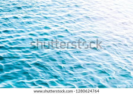 Background shot of aqua sea water surface ,bokeh (out of focus) #1280624764