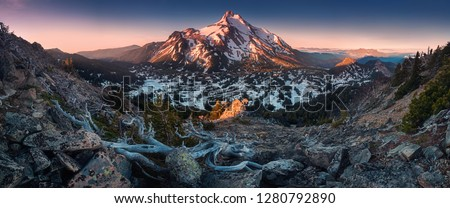 At 10,492 feet high, Mt Jefferson is Oregon's second tallest mountain.Mount Jefferson Wilderness Area, Oregon The snow covered central Oregon Cascade volcano Mount Jefferson rises above a pine forest #1280792890