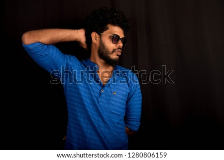 handsome young posing in studio #1280806159